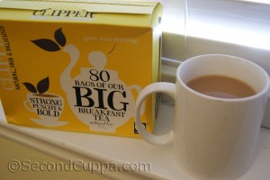 Package of Clipper Big Breakfast Tea beside a mug of tea