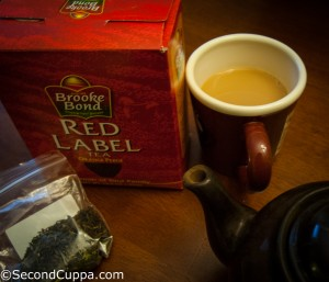 Image of Brooke Bond Red Label Tea package with teapot, mug and loose Darjeeling tea